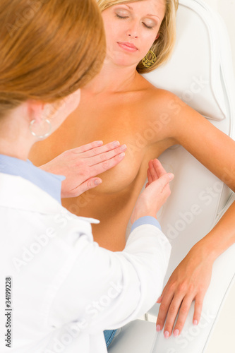 Plastic surgery doctor examine patient breast