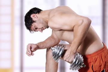 Powerful man lifting weights