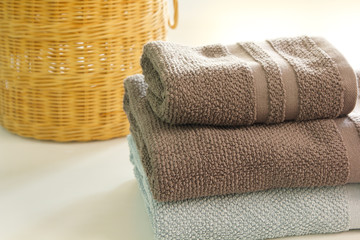pile of towel by a basket