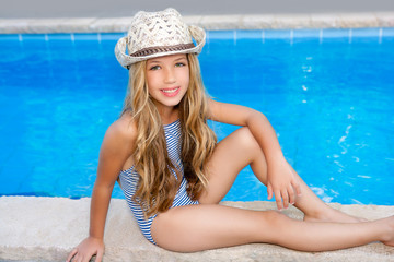 blond children girl sittin in swimming pool border