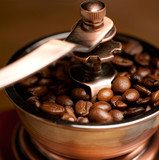 Close-up view of coffee grinder on vintage background