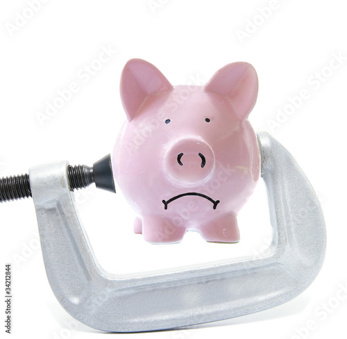 Sad piggy bank being squeezed in a vice Poster
