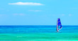 Panoramic beach landscape with windsurfer playing