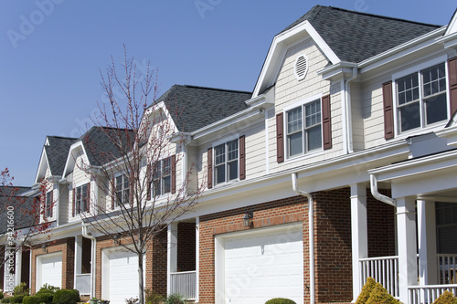 Row of townhouses in early springtime