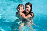 Smiling children in the swimming pool