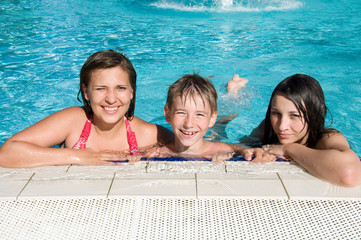 smiling kids in swimming pool