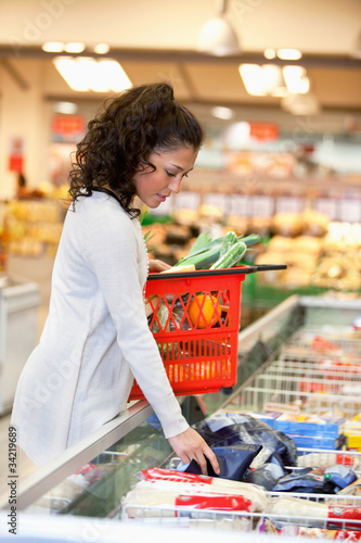 Woman Buying Frozed Food in Supermarket