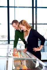 Couple Buying Frozen Pizza