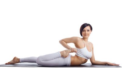 beauty woman in yoga bend  on rubber mat