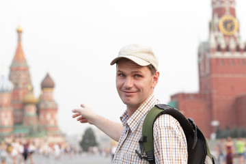 Tourist with backpack on Red Square, Moscow, Russia