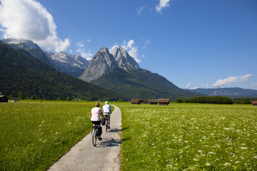 with a bicycle against mountains