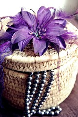 Rattan basket with flower and necklet