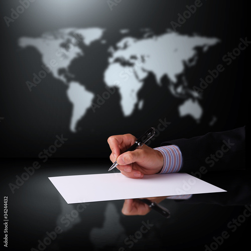 Businessman hand signing documents