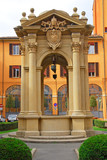 Italy, Bologna city council building old well.