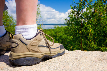 Rugged Hiker's Boot Overlooking Mountain Ledge
