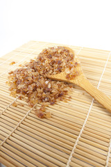 sweet sugar, rock sugar and wood ladle on japanese mat.