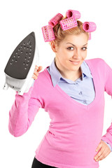 A woman with hair rollers holding an iron
