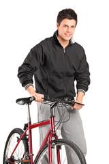 A young boy posing on a bike