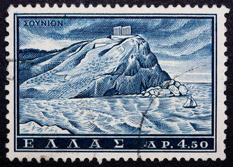 A Greek stamp showing a cliff with pillars on top