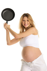 Smiling pregnant woman with frying pan