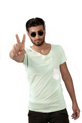 Peace sign - trendy ethnic man in sunglasses
