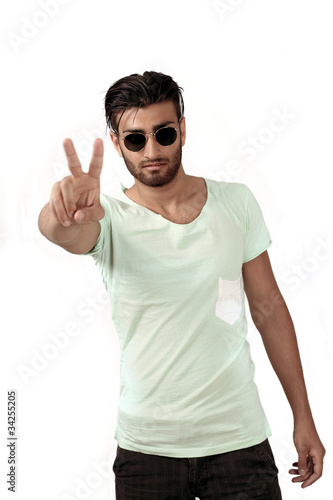 Peace sign - trendy ethnic man in sunglasses