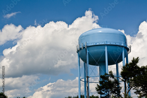 blue water tower under cloudy skies - 34255223