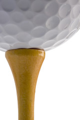 Closeup of golf ball sitting on tee