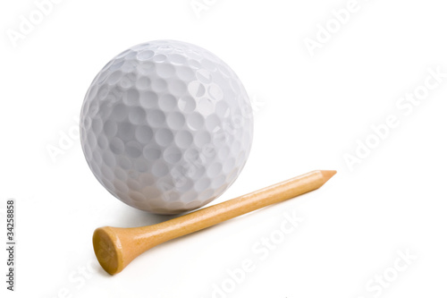 Golf ball with tee isolated on white