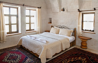 interior architecture white bedding under arches