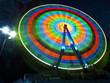 Ferris wheel rotates at night