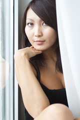 oriental girl at the window