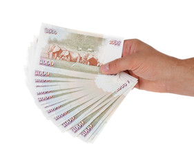 Hand holding Kenyan currency