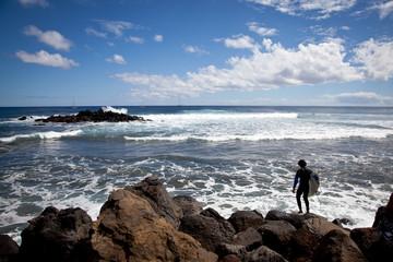 Surfing nearby Easter Island Coastline
