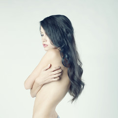Beautiful nude woman with long hair