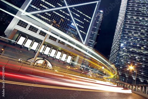 Urban landscape at night and through the city's traffic