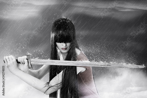 Fashion portrait of young pretty woman fighter - 34274803