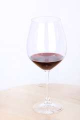 Wine in glass on wooden board