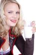 Blonde Frau im Dirndl leckt sich den Mund, Milch in der Hand