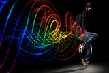 Fototapety Dancer with Waves of Light Over Black Background