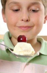 Boy with ice cream and cherry on top