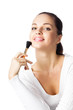 Young happy smiling woman with cosmetics brush, isolated