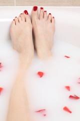 beautiful feet in milk bath