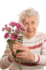 The old woman with a bunch of flowers