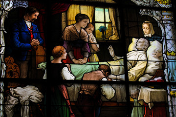 Family gathering at deathbed - stained glass