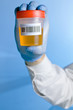 Urine container with code bar in blue background