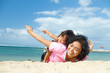 ethnic child fun with mother on tropical beach