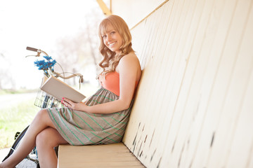 Beautiful Caucasian woman reading outdoor