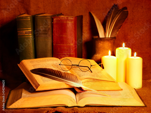 Stack old book and candle.