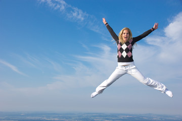 Jumping blond girl, concept of freedom